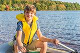 Boy in a boat in water