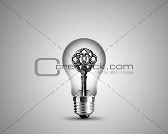 Old key in light bulb