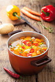 vegetable soup in red pot