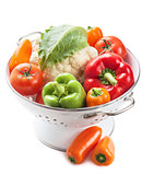 colorful vegetables in colander isolated
