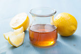honey and lemon over blue background