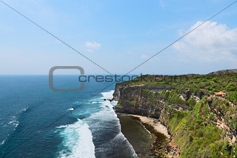 Cliffs above blue tropical sea