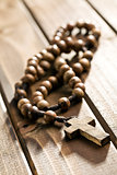 rosary beads on wooden background