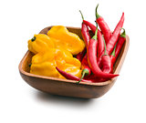 chili peppers and habanero in wooden bowl