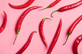 chili peppers on pink background