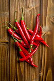 chili peppers on wooden background