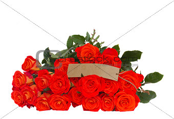 bright orange  roses with tag