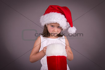 Little girl disapointed with her Christmas stocking