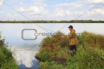 old fisherman with spinning rod