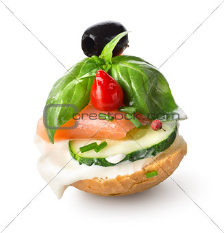 Sandwich with red fish and vegetables