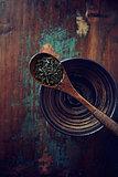 Green tea leaves (gun powder) on a wooden tea spoon