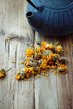 Dried Marigold Flowers and a cast iron tea pot