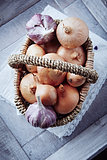 Onions and garlic bulbs in a basket