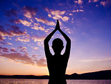 Silhouette yoga prayer pose