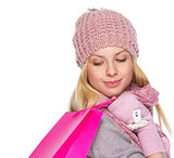 Girl in winter clothes with christmas shopping bag
