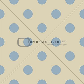 Retro seamless pattern or texture with big pastel blue polka dots on light beige, neutral background