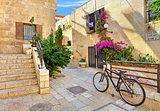 Street and stonrd houses at jewish quarter in Jerusalem.