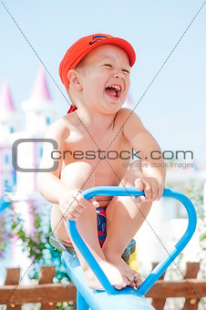 Happy child swinging on a swing