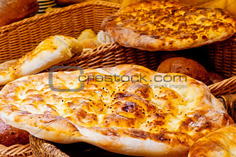 Bread cake lying on a basket with bread