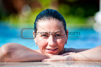 Portrait of happy girl in pool