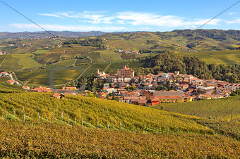 Autumnal view of vineyards and Barolo in Piedmont, Italy.