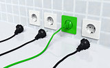 Ecological green plug into a green socket