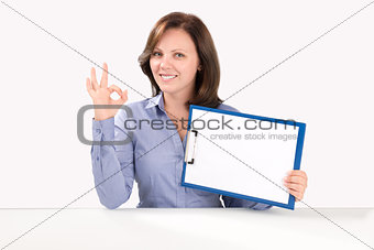 Business woman is holding a blank clipboard