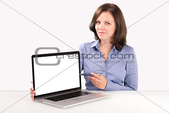 Business woman is demonstrating something on the laptop screen