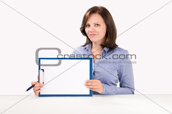 Business woman is holding a clipboard