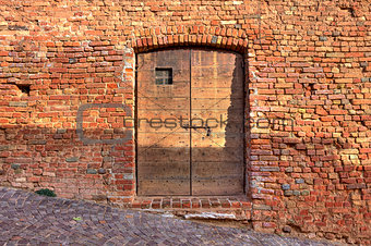 Brick wall with wooden door.