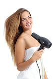 Beautiful woman with a towel drying hair with a dryer