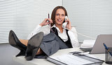 young businesswoman answering telephone