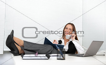 cute young office worker talking on phone in office