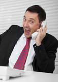 businessman screaming on the phone