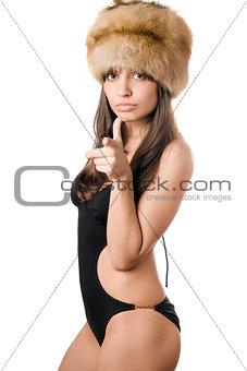 caucasian woman in swimsuit and fur-cap