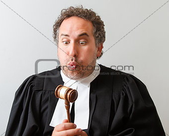 Blowing on the gavel