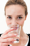 woman drinking water against white background