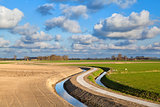 rural curved road for bikes in Dutch farmland