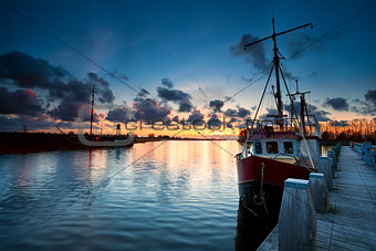 fishing ships at sunset in Zoutkamp