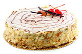 Esterhazy cake decorated with cherries and almonds.