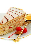 Esterhazy cake and red cherry.