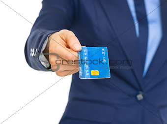 Closeup on business woman giving credit card