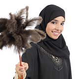 Arab housewife woman smiling and holding a duster clean