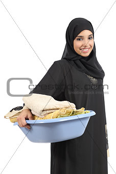 Beautiful arab woman carrying laundry