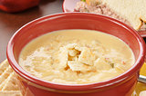 chicken con queso soup with a sandwich