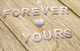 Forever yours on wooden background