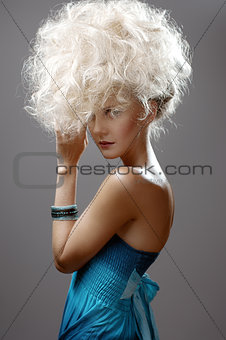 Beautiful Blonde Girl. Healthy Long Curly Hair