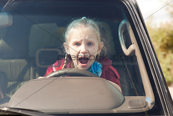 Crying scared girl in the car