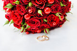 Wedding rings with a bouquet of roses