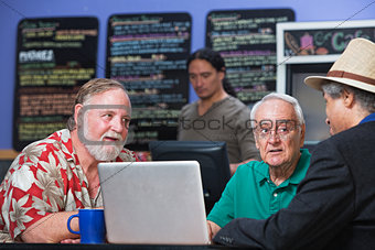 Group of Men with Laptop